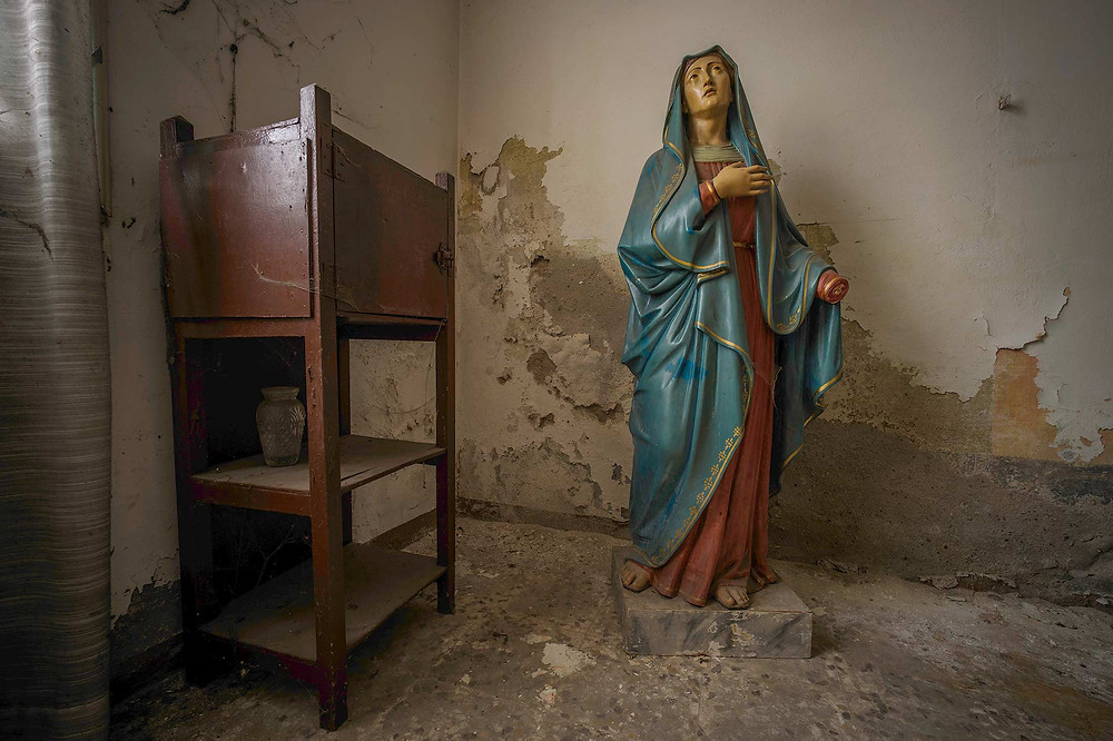 Statue at abandoned church Sisters of Decay