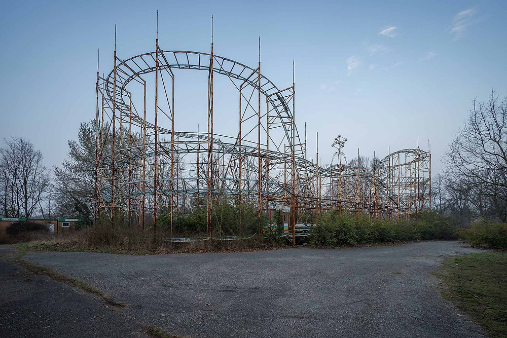Rusty rollercoaster in abandoned theme park in Italy