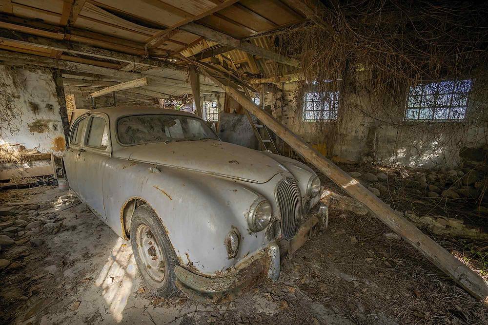 Abandoned Jaguar in garage