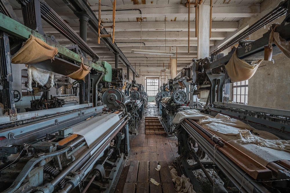 rows of old machines at abandoned weaving factory in Austria
