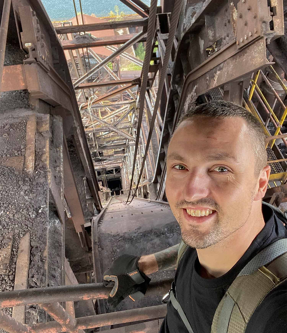 Selfie of Henrik Haupt from the top of the abandoned blast furnace