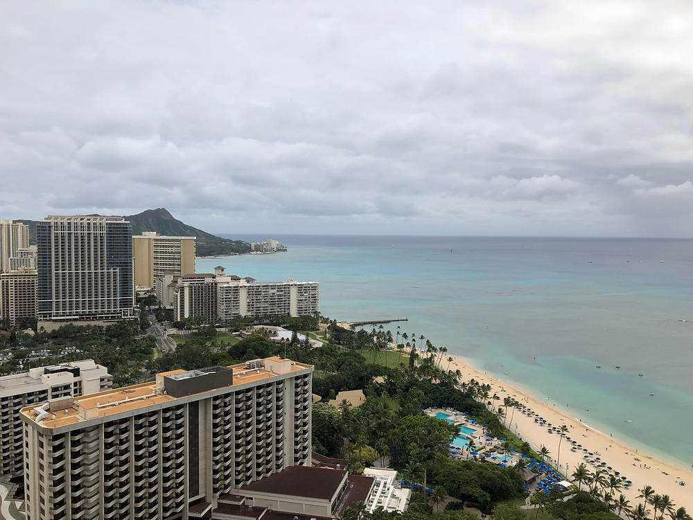 Looking towards Diamond Head from the Hilton Hawaiian Village, directly in the foreground is the Outrigger Reef and behind that with the nice pool is the luxurious Halekulani Resort