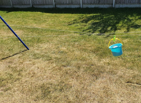 Keep the kids entertained with a bucket and some string.