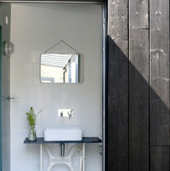 En-suite from outside, with charred cladding