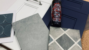 A colorful Navy Blue & White Shaker kitchen with a fun pattern floor