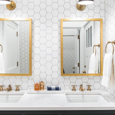 Cityscape Black Cabinets with White Hex and Gold accents