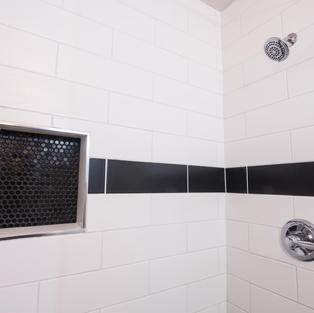 White and black subway tile with black niche