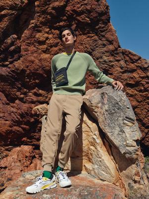 Calvin Klein fashion production - man on rock
