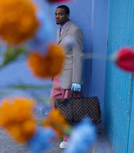 Louis Vuitton photography production - man behind flowers