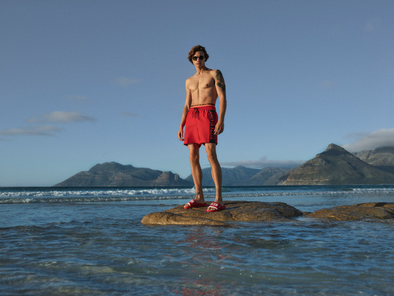 Calvin Klein red swimming trunks - photography on beach in Cape Town