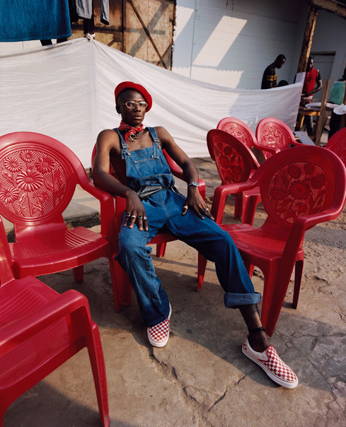 Self Service - portrait photography - sitting on red chairs