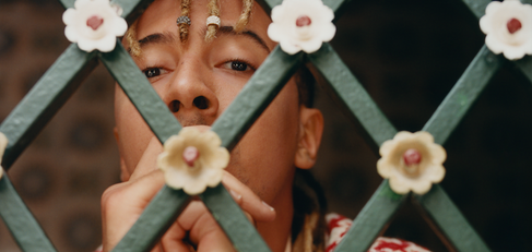 GUCCI video and film production - man behind bars with flowers - Tunisia