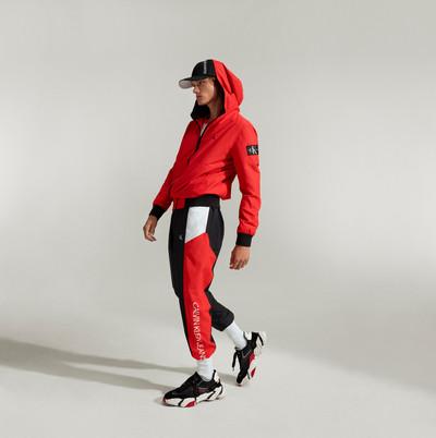 Calvin Klein fashion stills - man in red tracksuit