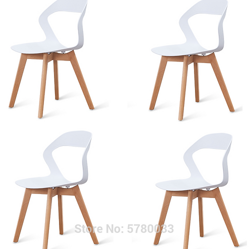 A Set of 4 Nordic Medieval Modern Minimalist Chairs With Wood Feet