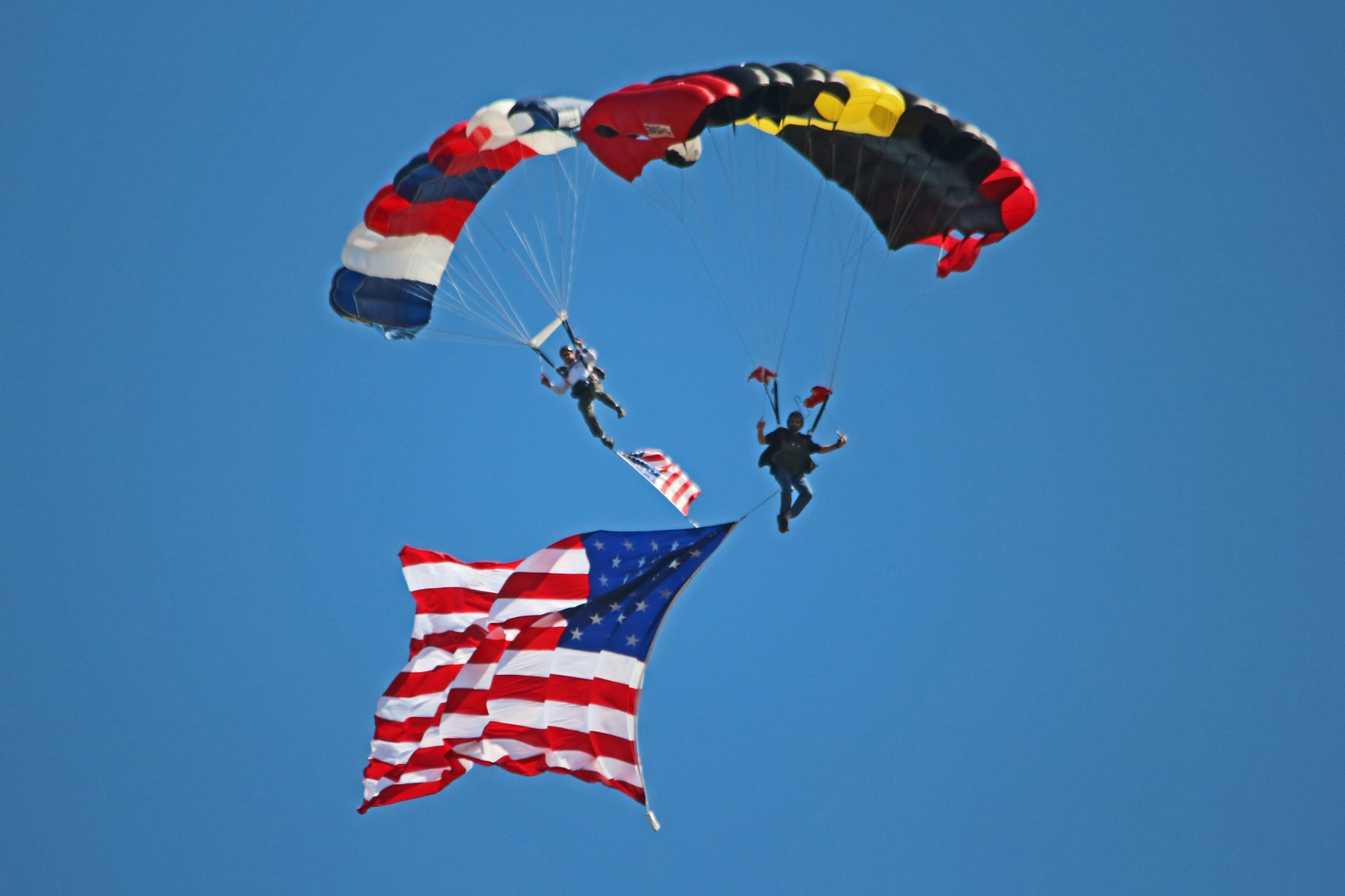 Stunt skydivers in action