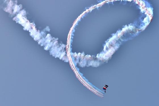 smoke trail skydiver