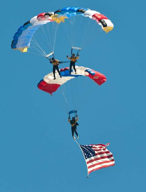 triple stunt skydivers in action
