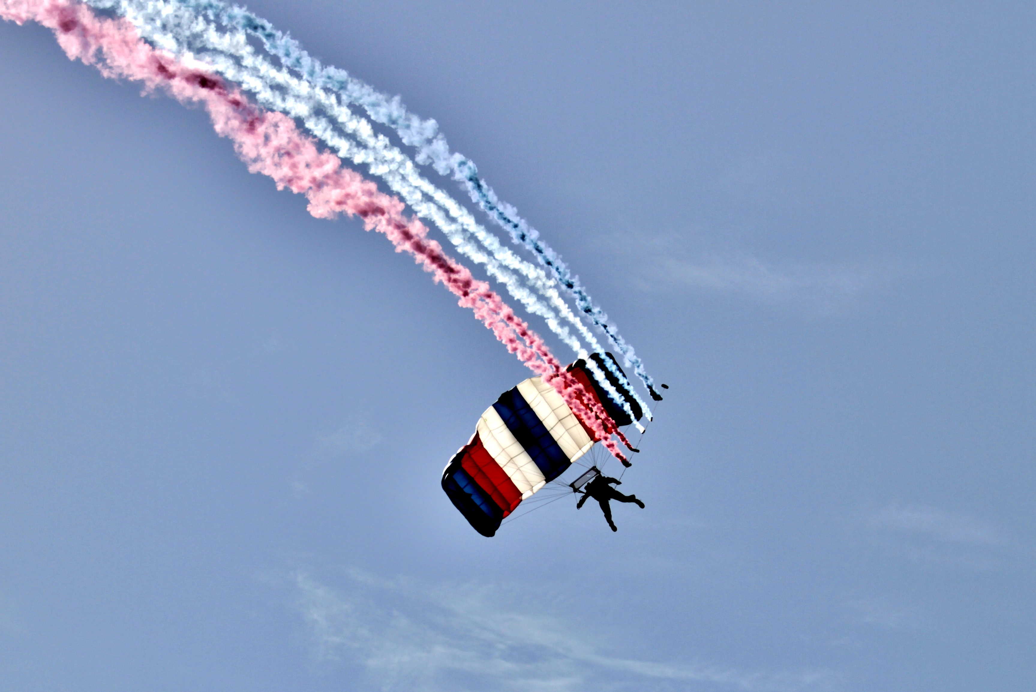 Smoke trail airshow skydiver