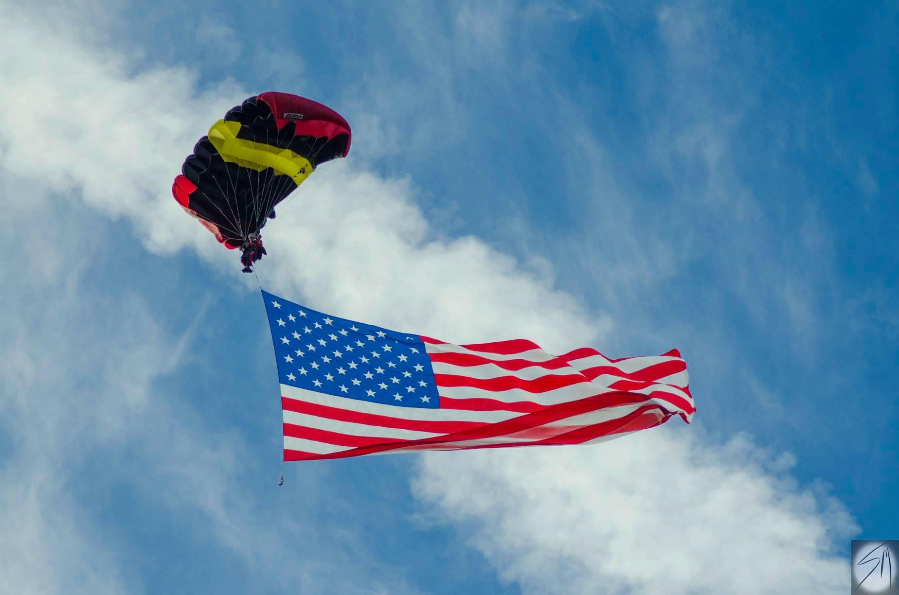 Giant USA flag jump skydiver