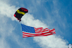 Giant USA flag jump skydiver