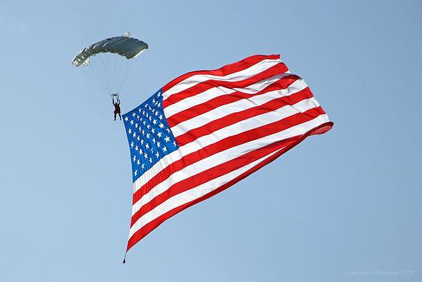 Skydiver wit giant USA flag