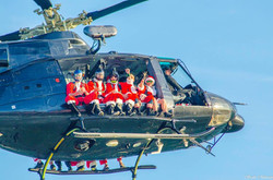 Santas Jumping Out of Helicopter