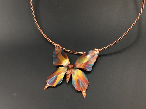 Butterfly pendant on neck band