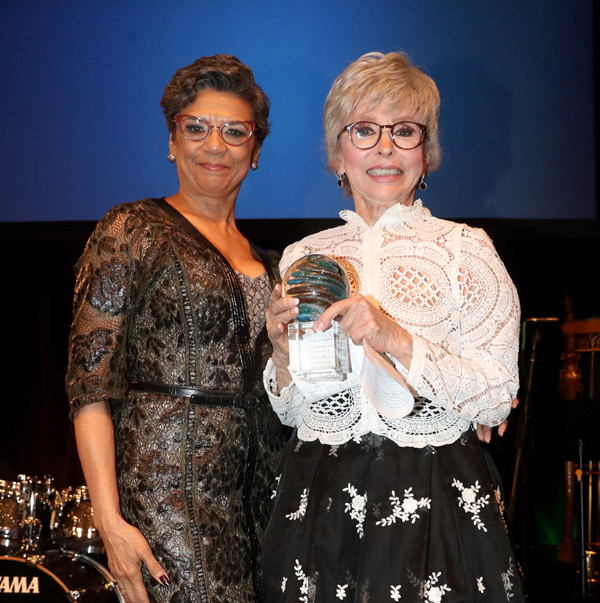 Rita Moreno accepting the Imagination Award from Soniz Monzano