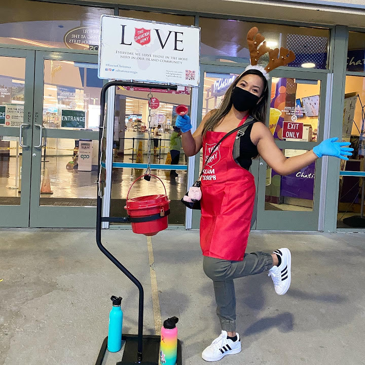 Lady with Salvation Army's red kettle