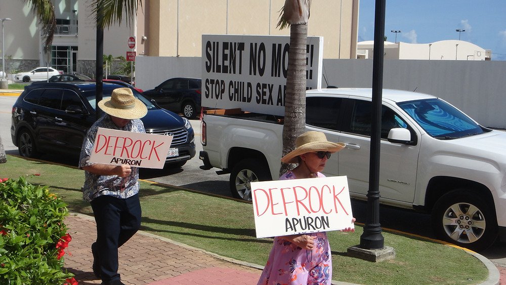 Protesters urging the Archdiocese of Agana to address allegations of clergy sex abuse.