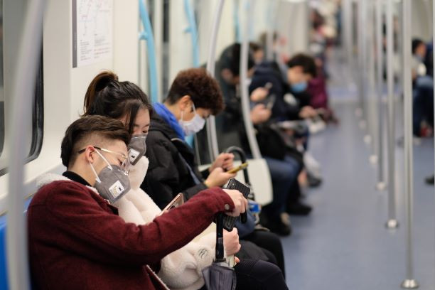 Chinese on a subway  cover their faces with masks for protection