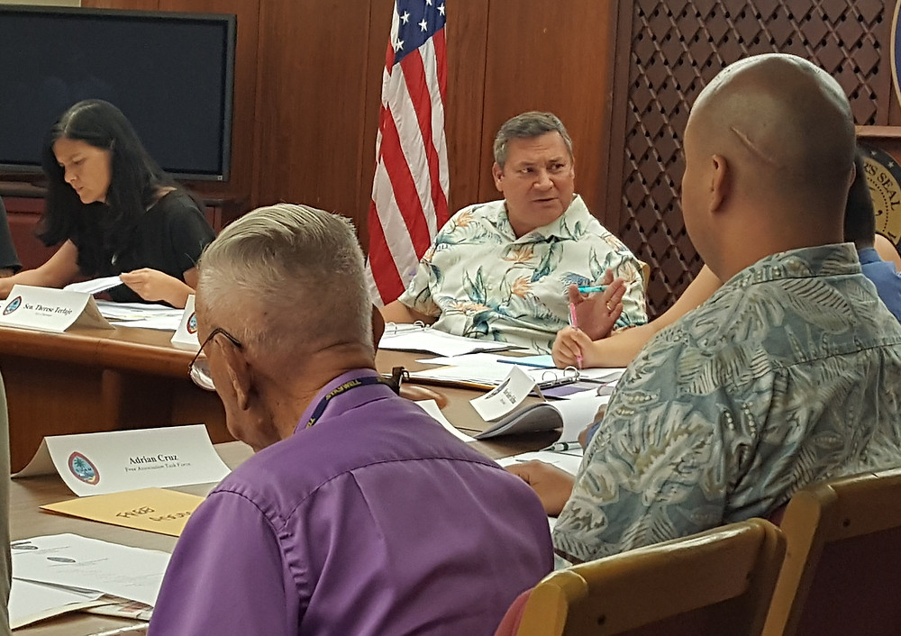Gov. Eddie Calvo presides over the Guam Decolonization Coimmission's meeting in Adelup on June 12.