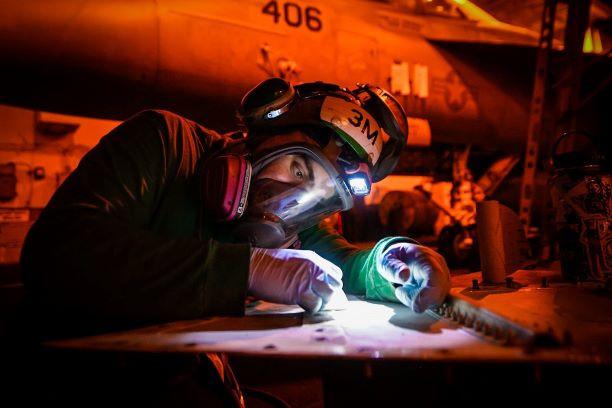 Maintenance work aboard USS Theodore Roosevelt
