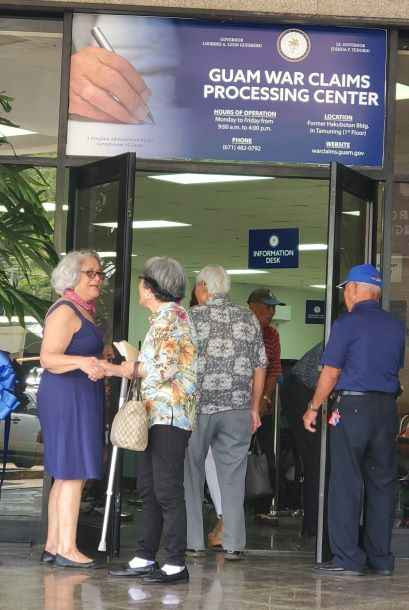 War survivors stand in line at the Guam War Claims Processing Center