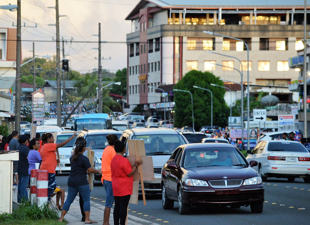 Political supporters stand by the roadside during a rush hour in Koror to make a last-minute pitch for the candidates they support. (Photo by Kambes Kesolei)