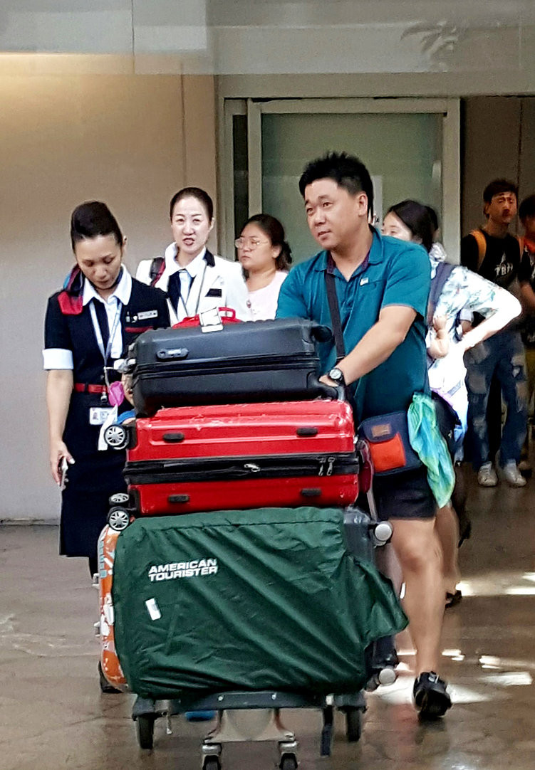 Korean tourists arriving in Guam