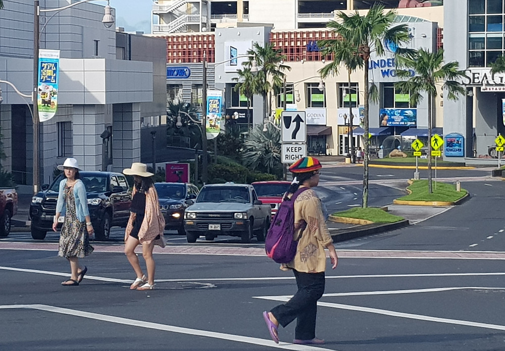 Tourists wallking in Tumon