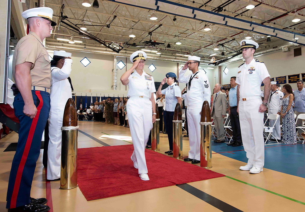 Rear Adm. Shoshana Chatfield is piped ashore during a change of command ceremony at the Guam High School gymnasium aboard U.S. Naval Hospital Guam in Agana Heights July 23. U.S. Navy photo by Mass Communications Specialist 3rd Class MacAdam Kane Weissman