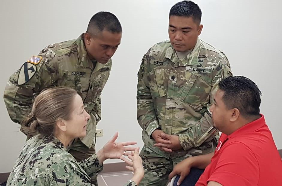 CNMI Gov. RalpTorres wth military personnel