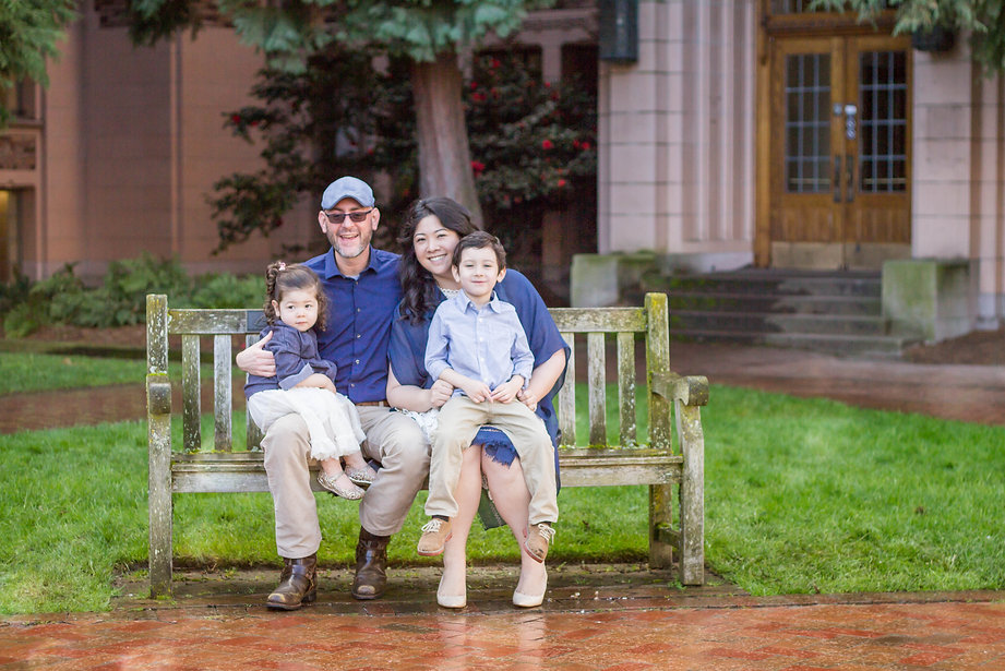 A gorgeous family enjoying spring and cherry blossoms at the UW's Quad in Seattle, WA