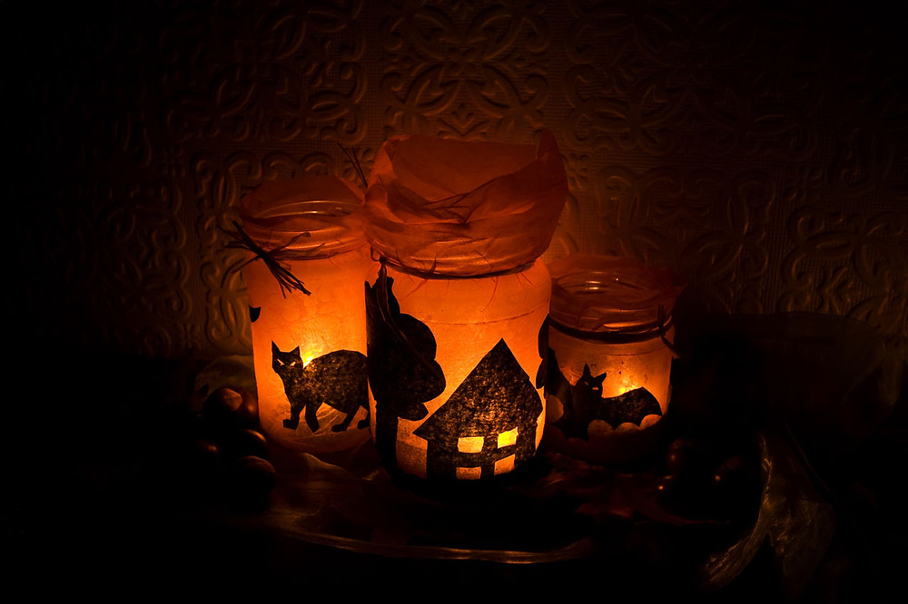 Halloween decor | a cat and a bat on lit up mason jars
