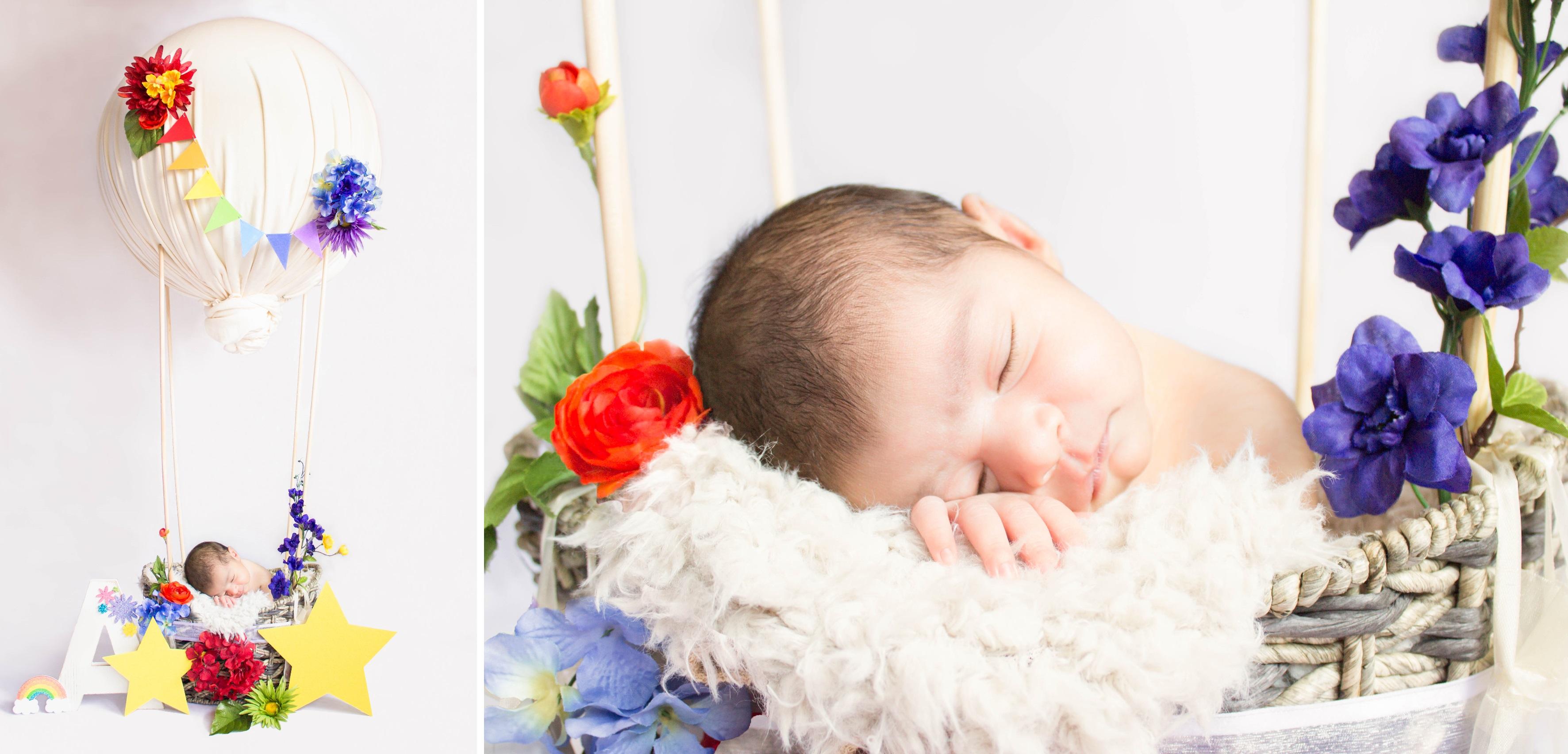 Newborn baby in hot-air balloon prop