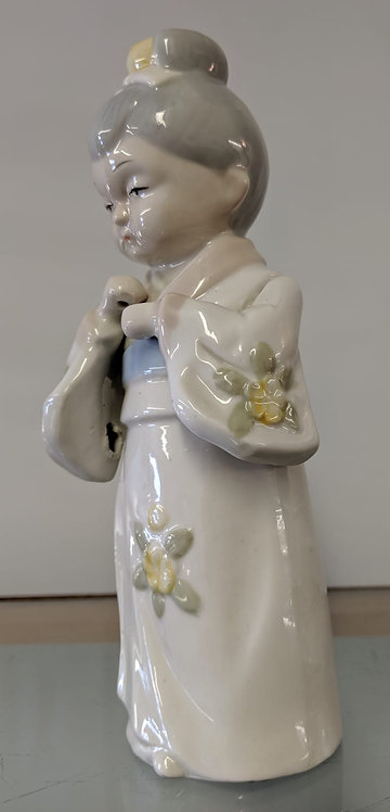 Porcelain figure of a young asian lady