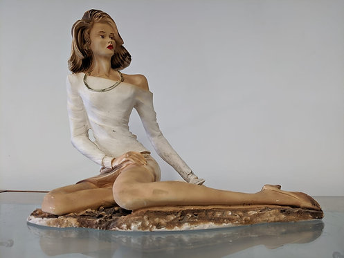 Resin statue of a seated lady