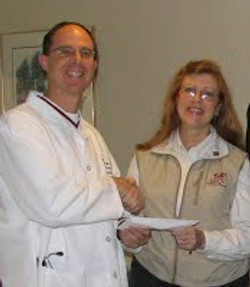 Photo of Nevada Physician with donation Nov.'05 cropped