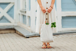 woman holding cotton grocery bag