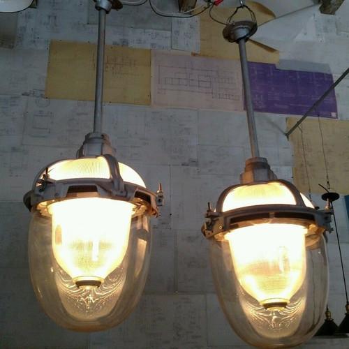 pair of rare reclaimed vintage industrial triple glass holophane pendants