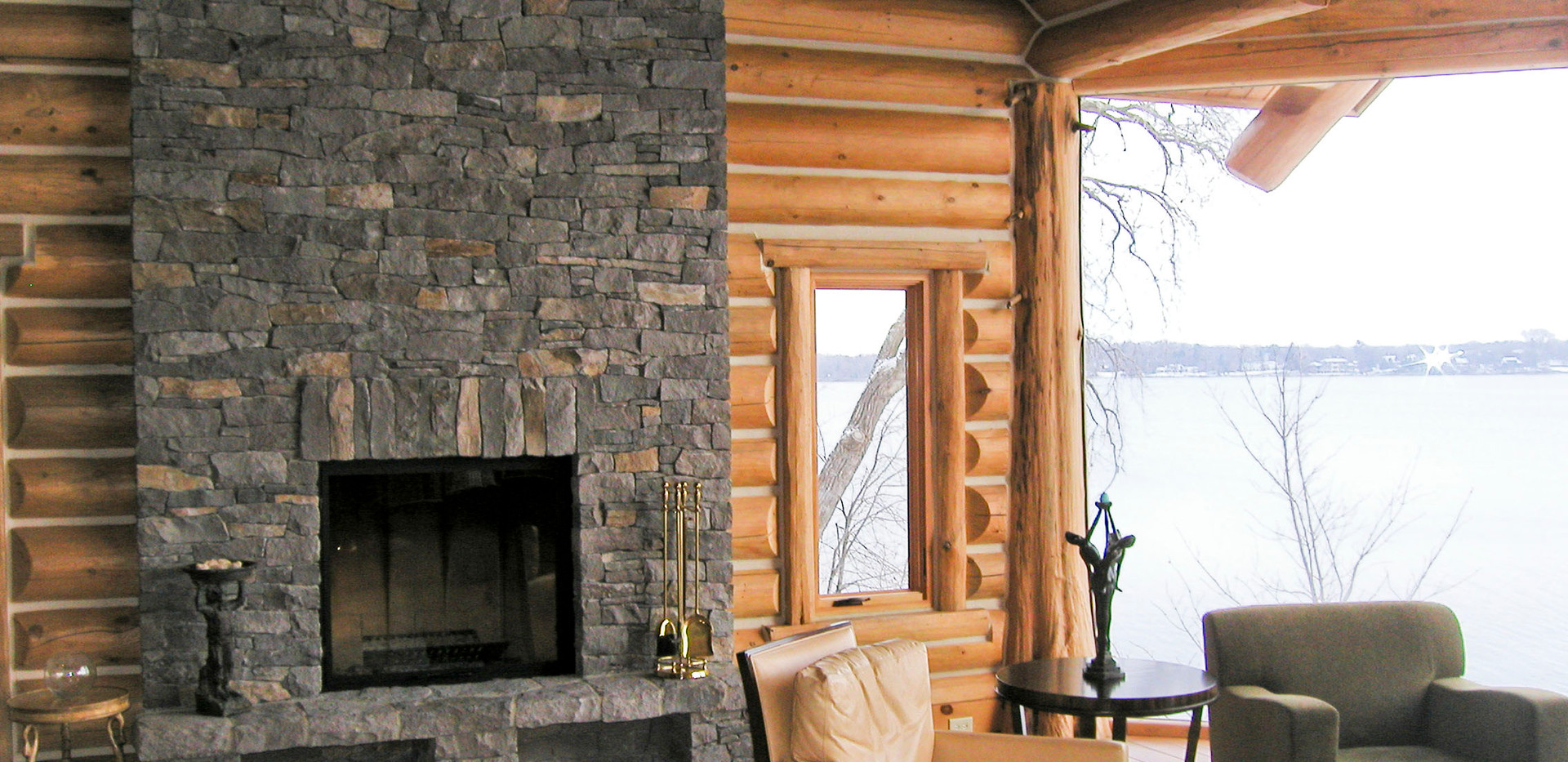 Log Home Living Room Fireplace.JPG