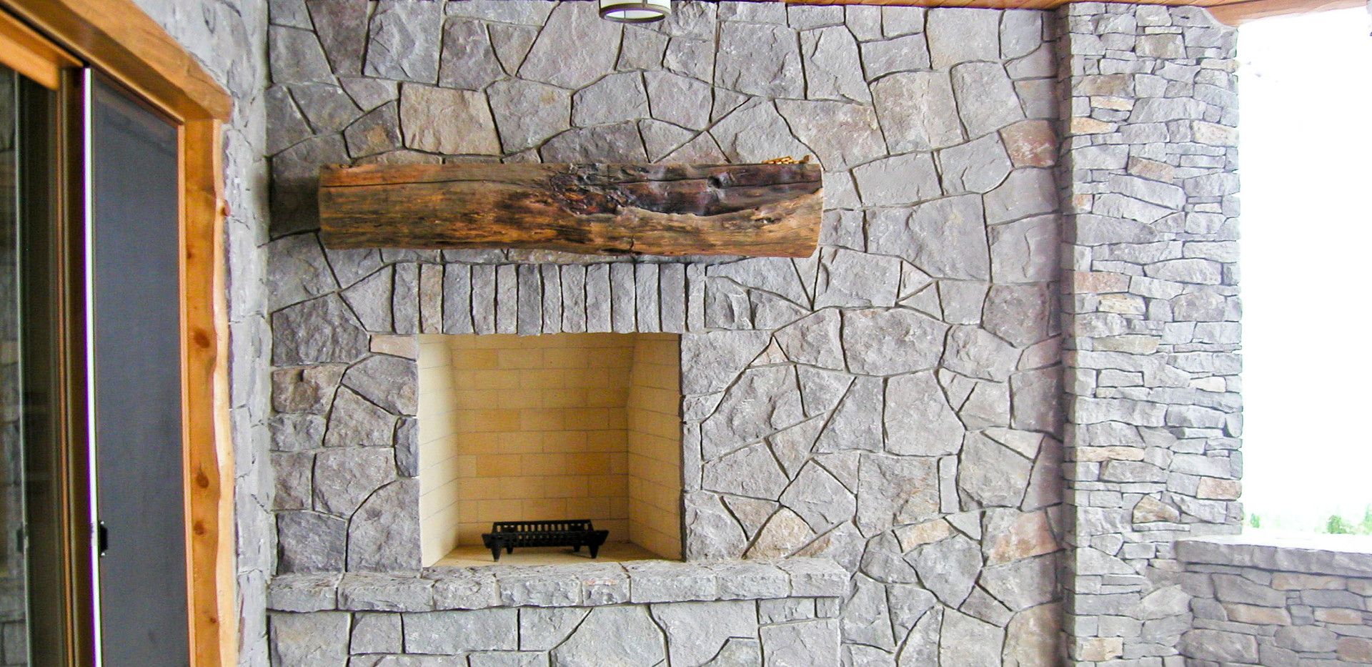 Log Home Outdoor Patio Fireplace.JPG