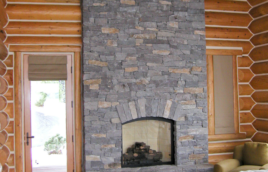Log Home Bedroom Fireplace.JPG